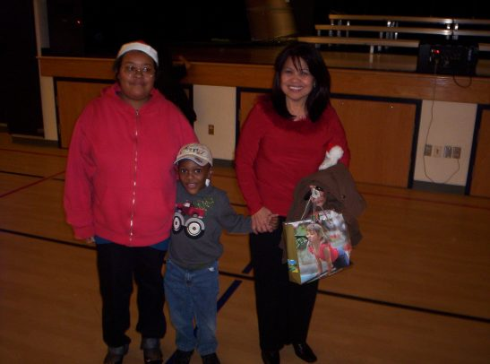 Donovan with his teacher (on the right) and the classroom aide.