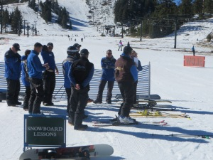 The ski and snowboard instructors in a morning meeting.